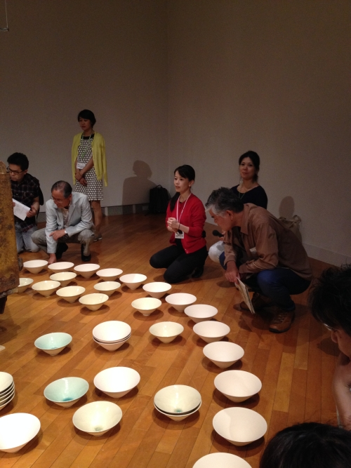 Artist Aiko Miyanaga and the public around sound installation Soramimimisora, 2014. © Aiko Miyanaga.